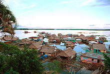 220px-Amazonas_floating_village,_Iquitos,_Photo_by_Sascha_Grabow